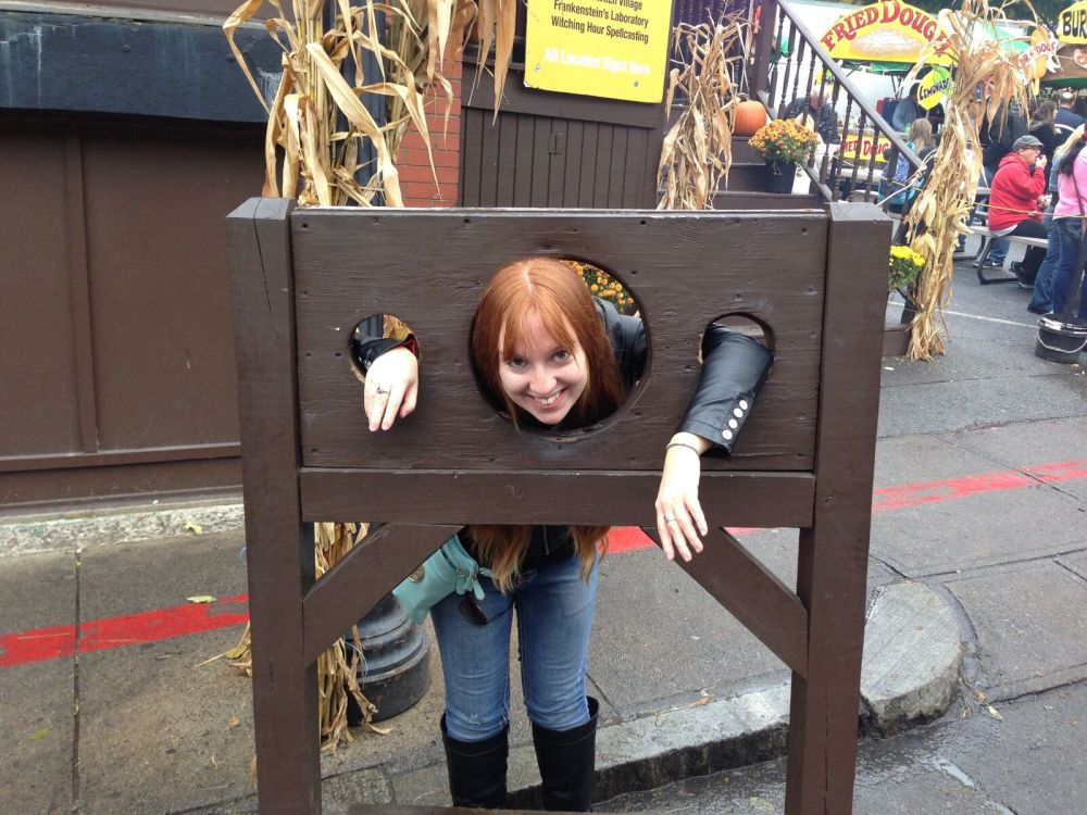 Locked in the stocks! I guess they think I'm a witch, must be the red hair...